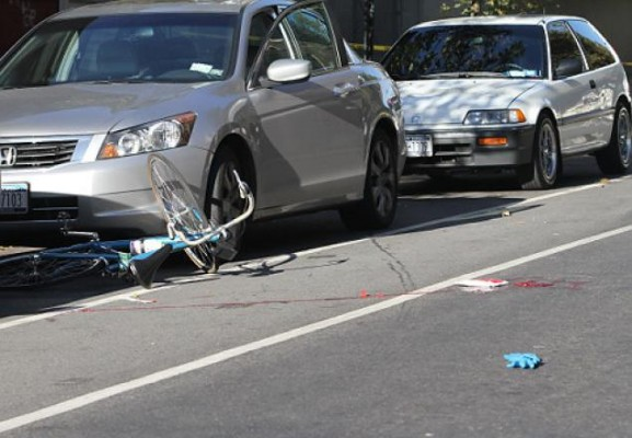 Open car door kills bicyclist Marcus Ewing, 27