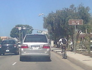 Adult bicyclist riding in the gutter Source: Dan Gutierrez